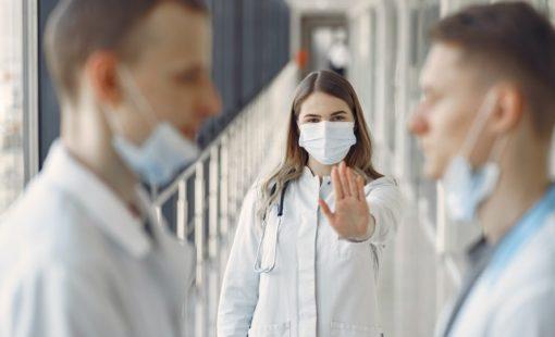woman-stopping-men-not-wearing-proper-face-mask-3985151